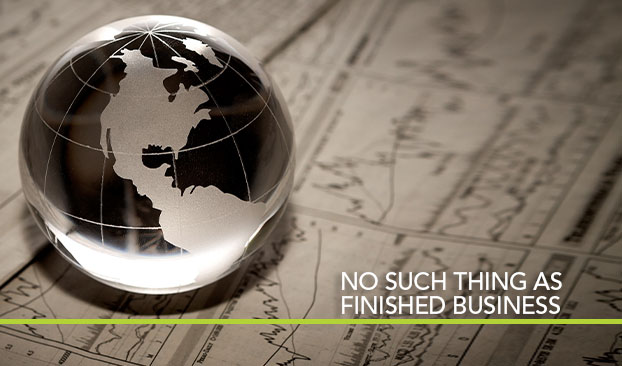 glass globe on investment paperwork, titled No Such Thing as Unfinished Business